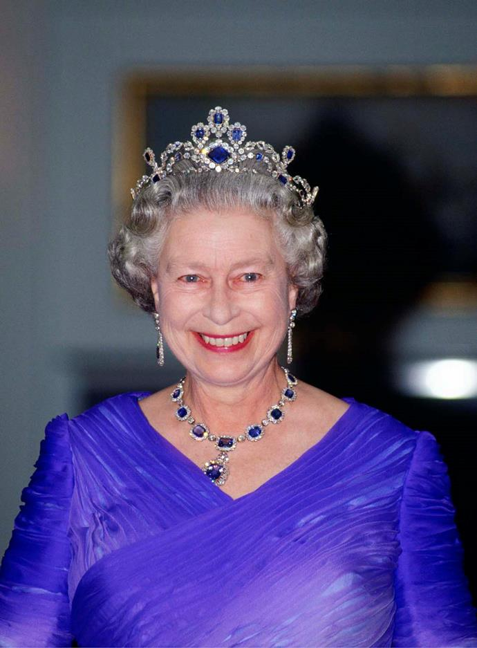 **The tiara:** The George VI Sapphire Tiara.<br><br> **The wearer:** Queen Elizabeth II of England.<br><br> **The details:** Made with cushion- and lozenge-cut sapphires, this tiara also features round-cut diamonds on a platinum base.<br><br>