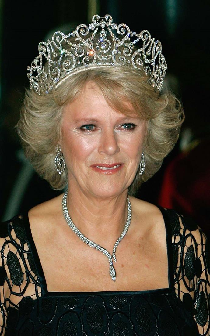 **The tiara:** The Delhi Durbar Tiara.<br><br> **The wearer:** Camilla, Duchess of Cornwall.<br><br> **The details:** Although it is more regularly worn without, this giant tiara can be topped by 10 cabochon emeralds or the colossal 95-carat Cullinan III diamond.<br><br>