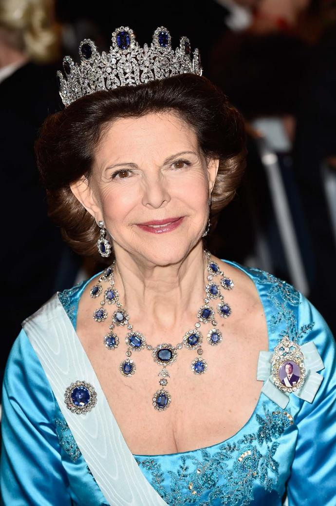 **The tiara:** The Leuchtenberg Sapphire Tiara. <br><br> **The wearer:** Queen Silvia of Sweden.<br><br> **The details:** Made of floral and leaf motifs, the tiara was originally made to house pearls which were then swapped out for the 11 sapphires you see now.<br><br>