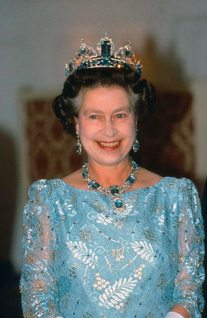 **The tiara:** The Brazilian Aquamarine Parure Tiara.<br><br> **The wearer:** Queen Elizabeth II of England.<br><br> **The details:** Made from aquamarines given to The Queen by the people of Brazil to celebrate her coronation in 1953, this tiara incorporates large emerald-cut aquamarines, set in platinum. <br><br>