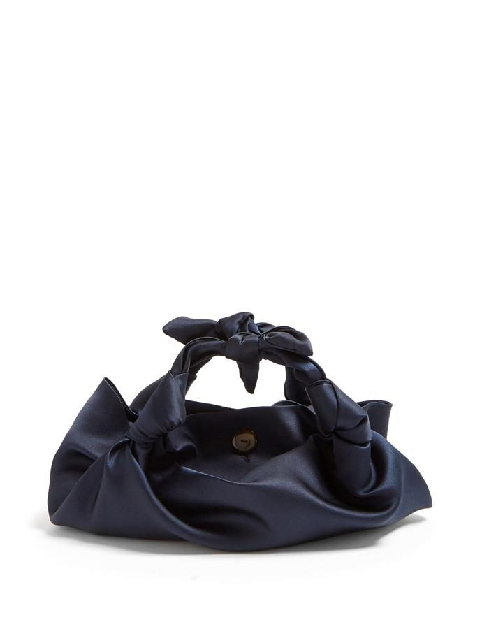 "Bag by The Row, $1360, at [MATCHESFASHION](https://www.matchesfashion.com/au/products/The-Row-The-Ascot-satin-clutch-1255549|target=""_blank""