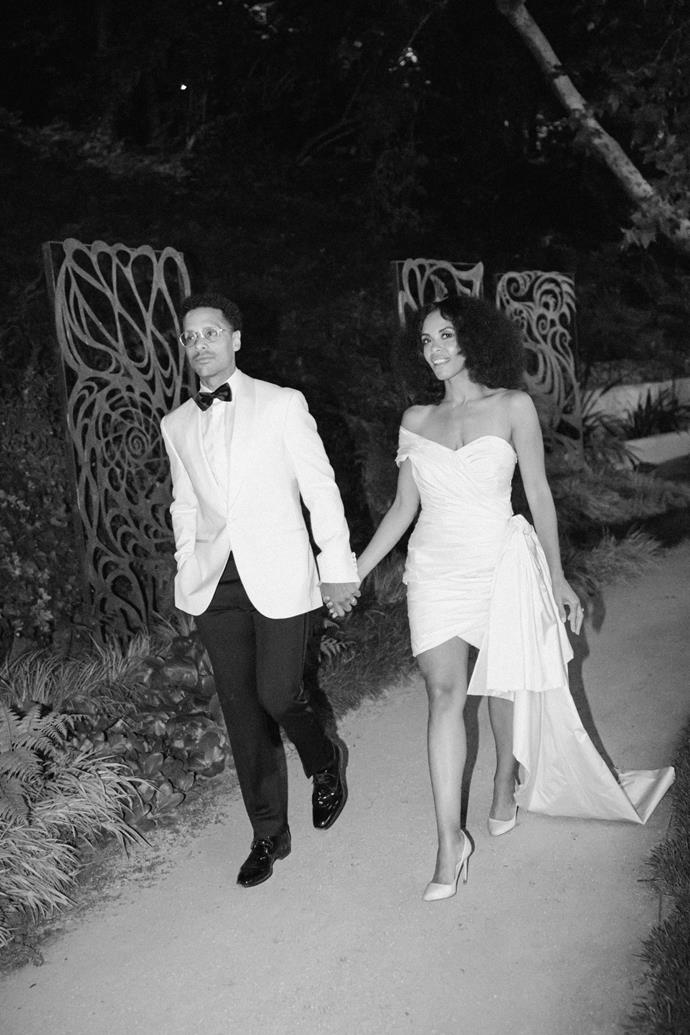 """**Was there an outfit change for the reception?** Yes, for the reception I changed into an Oscar de la Renta one-shoulder taffeta dress paired with Jimmy Choo """"Romy 100"""" ivory satin pointy-toe pumps. Mario changed into an Ivory shawl collar dinner jacket by Jack Victor."""