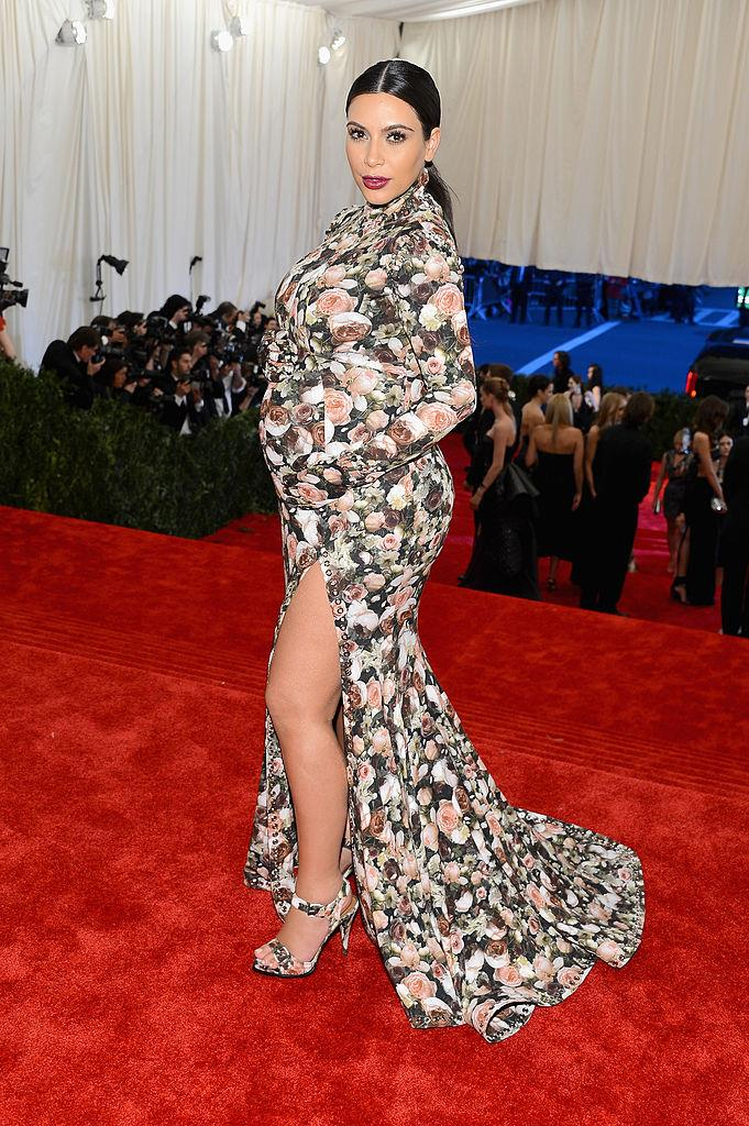 **Kim Kardashian West in Givenchy by Riccardo Tisci at the 2013 Met Gala** <br><br> The Givenchy dress that KKW wore to her first-ever Met Gala became one of the most meme'd, parodied, and talked-about outfits of the entire decade, and in hindsight, we can't help but respect its impact. In fact, Kardashian later revealed that she was complemented on the look by Ashley Olsen, which we'd argue is one of the biggest industry endorsements you could get.