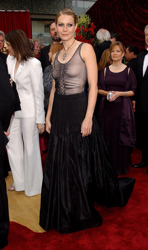 "**Gwyneth Paltrow in Alexander McQueen at the 2002 Academy Awards** <br><br> In a major departure from her pink gown three years prior, Paltrow's goth McQueen number at the 2002 Oscars was misunderstood by many. Even though Paltrow admitted in 2013 that she ""should have worn a bra"" to accompany the sheer top, the look was the perfect fashion renegade moment, and McQueen himself even admitted that she looked ""incredible""."