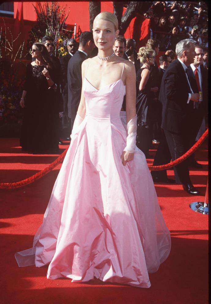 **Gwyneth Paltrow in Ralph Lauren at the 1999 Academy Awards** <br><br> Accepting her Oscar for *Shakespeare in Love* in 1999, Paltrow's famous pink Ralph Lauren ball gown quickly became the reference point for any princess-style gowns that followed—and whether or not it's your cup of tea, you can't deny its impact.
