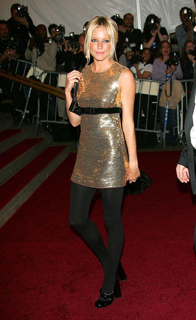 **Sienna Miller in Burberry at the 2006 Met Gala** <br><br> By all intents and purposes, the Met Gala is, well, a *gala*—so when Sienna Miller arrived in this Burberry mini at the 2006 event, some considered her to be underdressed. Almost 14 years later, and the look has aged like a fine wine, paying homage to the simplicity of British fashion (which was the theme of the night, by the way).