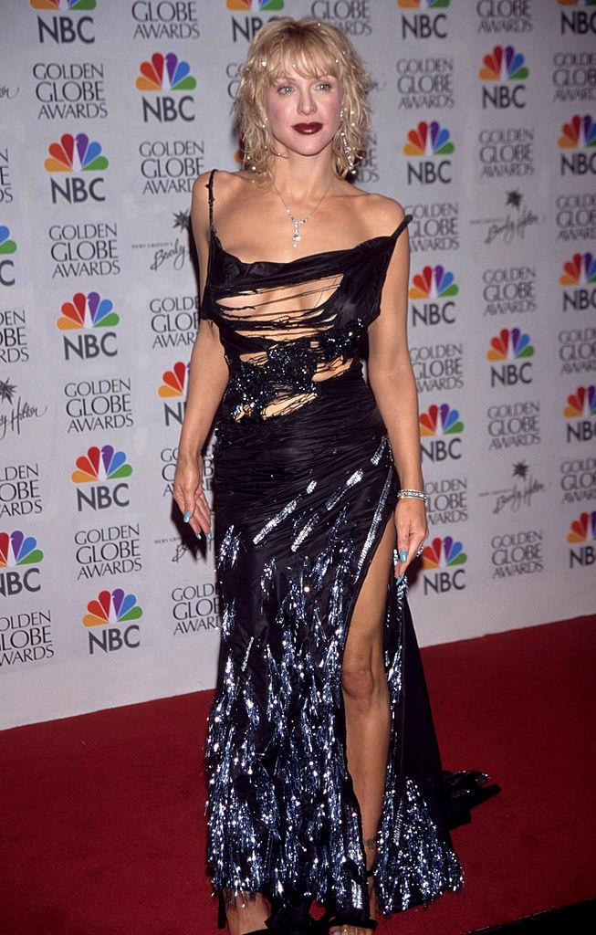 **Courtney Love in Dior at the 2000 Golden Globes** <br><br> Though some might turn their nose up at the slashed silhouette of Love's 2000 Globes dress (from a Dior collection that was infamously inspired by the homeless), the simple hair and strappy shoes helped elevate the look, and in time, it was eventually recognised for being a major fashion moment.
