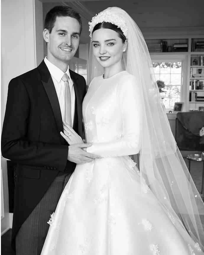 """**Miranda Kerr in Dior** When Kerr married Snapchat CEO Evan Spiegel in 2017, she wore this divine sleeved gown, designed bespoke by Dior creative director Maria Grazia Chiuri. The supermodel later revealed that it was inspired by [Grace Kelly's wedding dress](https://www.harpersbazaar.com.au/fashion/grace-kelly-second-wedding-dress-14555