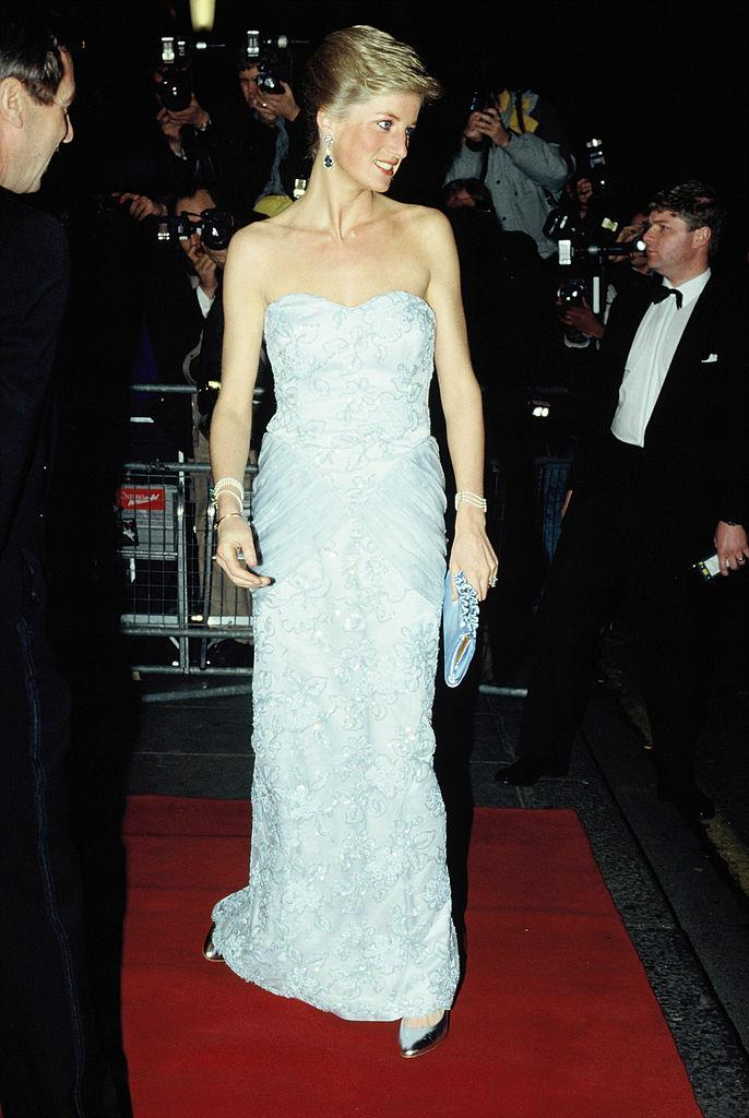 Months earlier in March, she was spotted at the same location to attend a performance of Moulin Rouge. The princess wore an icy-blue strapless dress by Catherine Walker at the time.
