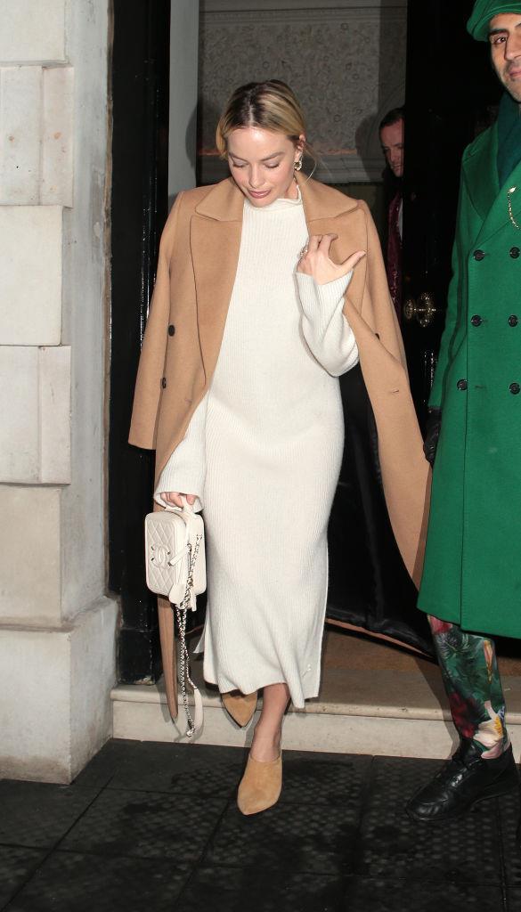 "Margot Robbie in a $299.95 belted wool coat by [Mango](https://shop.mango.com/au/women/coats-coats/belted-wool-coat_67021002.html?c=09|target=""_blank""|rel=""nofollow"") in January 2020."