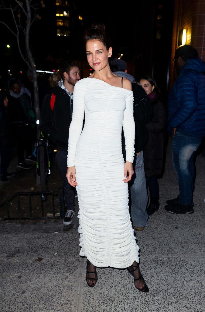 In a ruched white column dress while attending an Australian bushfire benefit in New York City on January 30, 2020.
