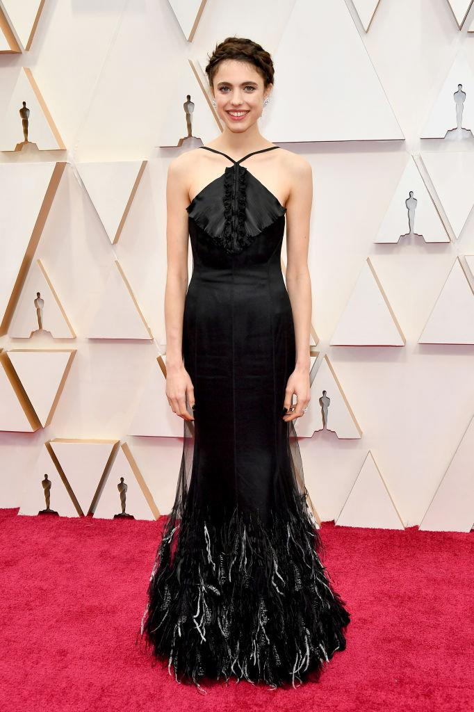 "**Margaret Qualley in Chanel Haute Couture** <br><br> ""Equal parts obsessed with Margaret Qualley's quirk, and her in this fun Chanel number."" *— Elle McClure, Culture Director* <br><br> ""Following her christening as a newly-minted Chanel girl, Qualley's latest Haute Couture number for the Oscars (which Adut Akech originally modelled on the runway) is understated perfection."" *— Jonah Waterhouse, Digital Writer*"