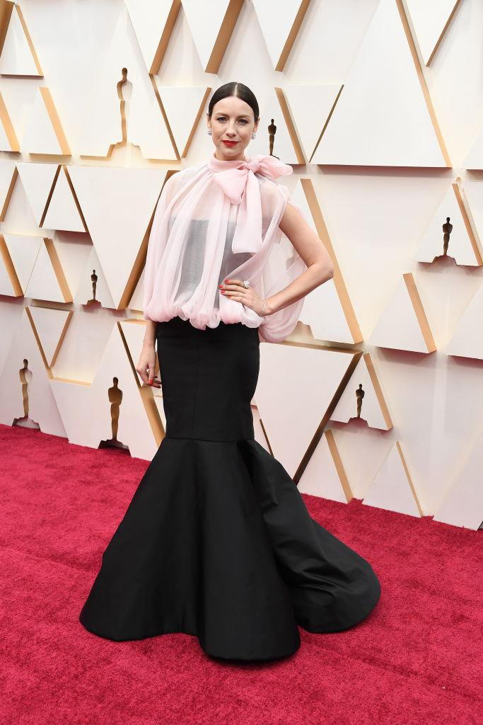 "**Caitriona Balfe in Valentino Haute Couture** <br><br> ""This Valentino couture creation is pretty striking, and her disciplined hair, makeup and jewellery don't crowd the geometry. (And you really don't want crowded geometry at the Oscars.)"" *— Tom Lazarus, Copy Director*"