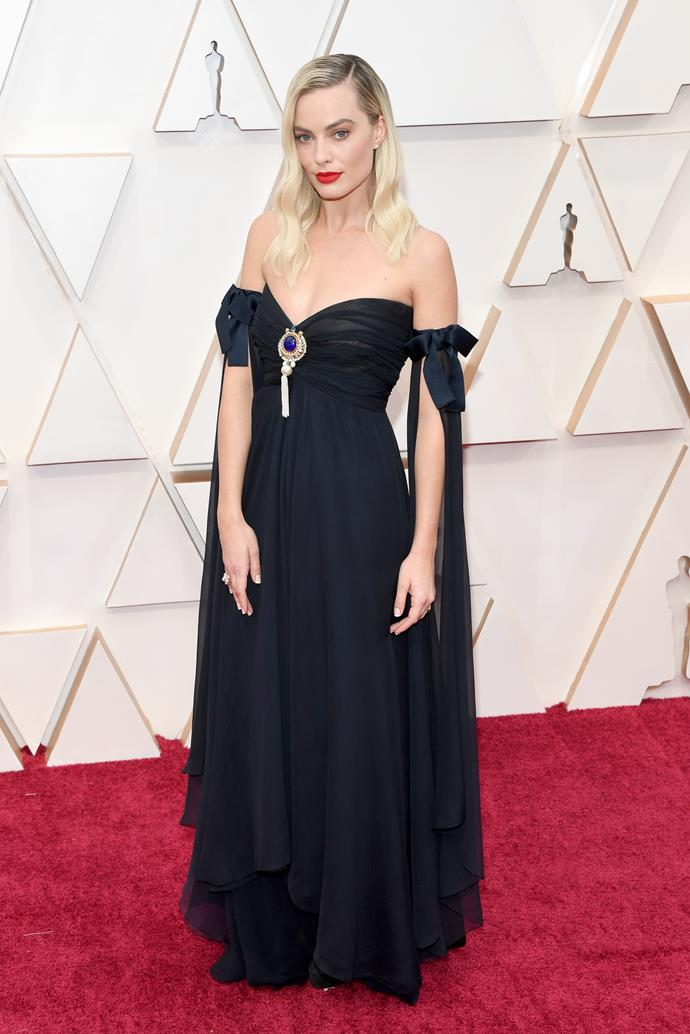 Chanel ambassador Margot Robbie wore a couture gown from  Chanel's spring summer '94 couture collection.