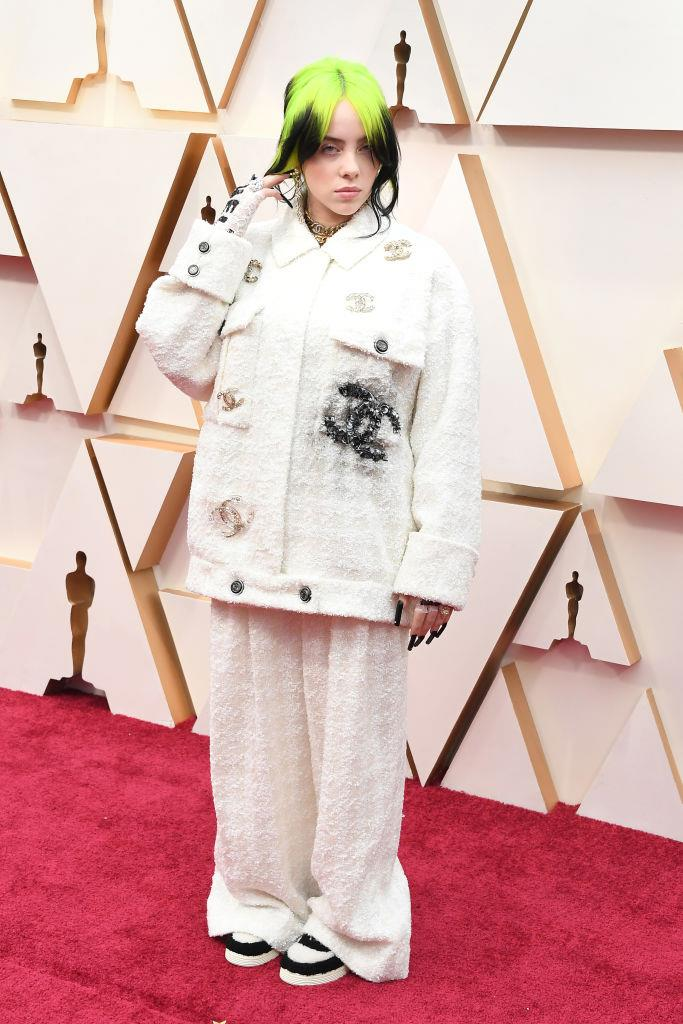 "**Billie Eilish in Chanel** <br><br> ""A masculine-feminine suit is one thing, but opting for this oversized Chanel two-piece is the ultimate red carpet power play. Eilish continues to subvert traditional event dressing and remain true to her aesthetic, while still observing the dress code."" *— Kate Lancaster, Beauty Writer*"