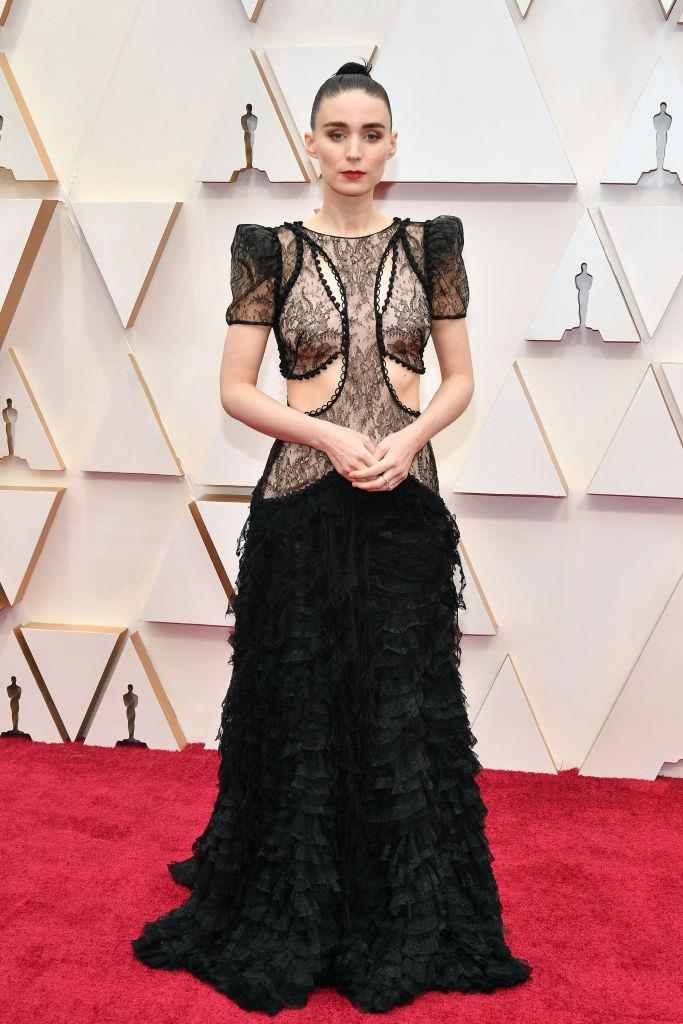 "**Rooney Mara in Alexander McQueen** <br><br> ""The gothic gown of dreams. Love the pairing of the opulent design with an uncontrived slicked bun, brushed-up brows and crimson lips."" *— Kate Lancaster, Beauty Writer* <br><br> ""While we love seeing Mara in Givenchy, this McQueen look is a welcome change. The structured shape and intricate detail help to give the 'naked dress' concept a gothic switch-up, courtesy of creative director Sarah Burton."" *— Jonah Waterhouse, Digital Writer*"