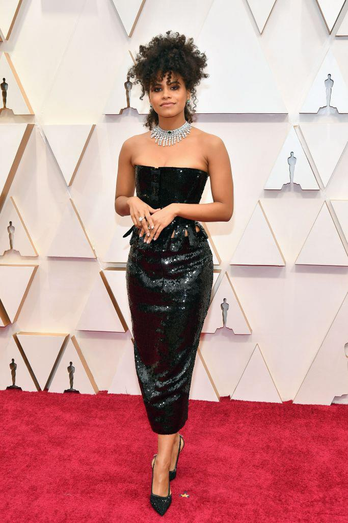 "**Zazie Beetz in Thom Browne** <br><br> ""Cardi B's 2019 Met Gala dress left me craving more red carpet quirkiness from Thom Browne, and this unconventional sequinned two-piece was magical on *Joker* star Zazie Beetz. The jagged-cut style of the top's lower half doesn't hurt, either."" *— Jonah Waterhouse, Digital Writer*"