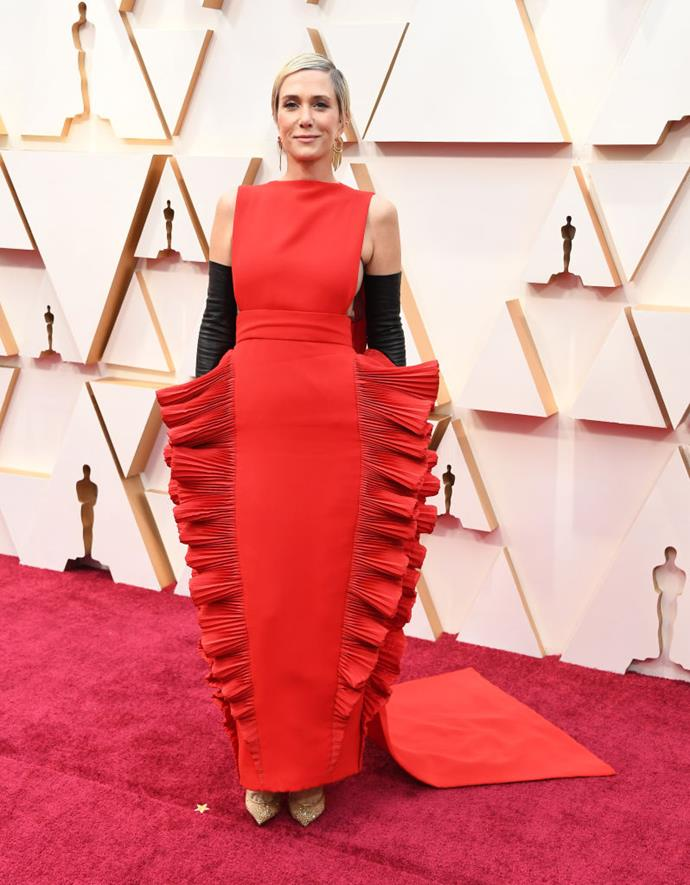 "**Kristen Wiig in Valentino Haute Couture** <br><br> ""Another star that always brings her own brand of style to the red carpet, I love that Kristen rarely plays it safe. Here, the theatrical silhouette with slicked back hair and smoky eyes just works."" *— Brooke Le Poer Trench, Beauty and Wellness Director*"