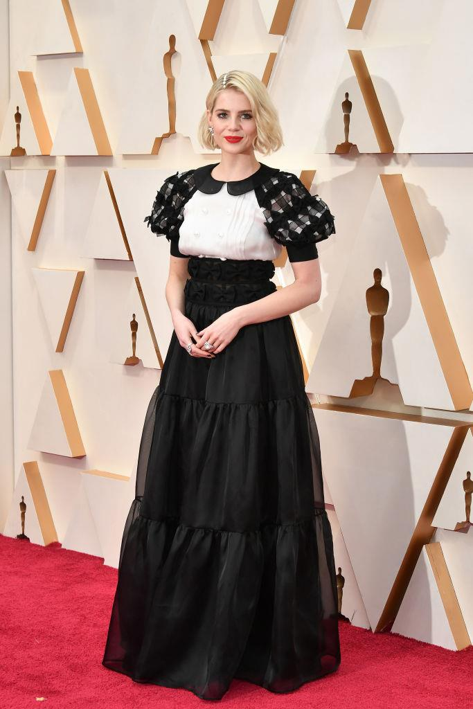"**Lucy Boynton in Chanel** <br><br> ""True to form I am immediately drawn to a puff sleeve, so Lucy Boynton's monochromatic Chanel dress gets my vote. Her stylist Leith Clark can do no wrong in my eyes, and this was the perfect example of her signature romantic aesthetic, worn so beautifully by Boynton."" *— Georgie Haigh, Digital Managing Editor*"