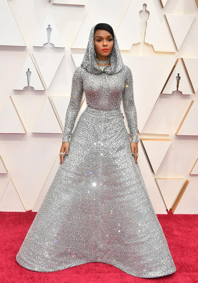 "**Janelle Monáe in custom Ralph Lauren** <br><br> ""For me, the red carpet is the perfect place for hoods and capes and insane volume. I am here for this couture-meets-*Merlin* mood."" *— Brooke Le Poer Trench, Beauty and Wellness Director* <br><br> ""This look was elegantly outrageous yet outrageously elegant. Head-to-hem iridescence is something few can can pull off and she did so with aplomb (and then some)."" *— Sukriti Wahi, Digital Writer*"