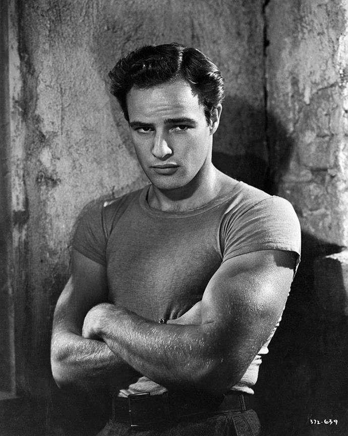 """**Marlon Brando as Stanley Kowalski in** ***A Streetcar Named Desire***<br><br>  Marlon Brando's portrayal of the violent Stanley Kowalski in film adaptation of Tennessee Williams' *A Streetcar Named Desire* was arguably his first big role—but it was also a character that continued to haunt him long afterwards.<br><br>  Brando actually wrote about his hate for Stanley in his autobiography, *Songs My Mother Taught Me*. There, he detailed how much he loathed how people had begun to conflate his real-life persona with that of his brutish character's.<br><br>  They were, however, nothing alike, with Brando claiming that he'd based his performance on different guys he knew who were """"muscled, inarticulate, aggressive animals who go through life responding to nothing but their urges and never doubting them."""""""