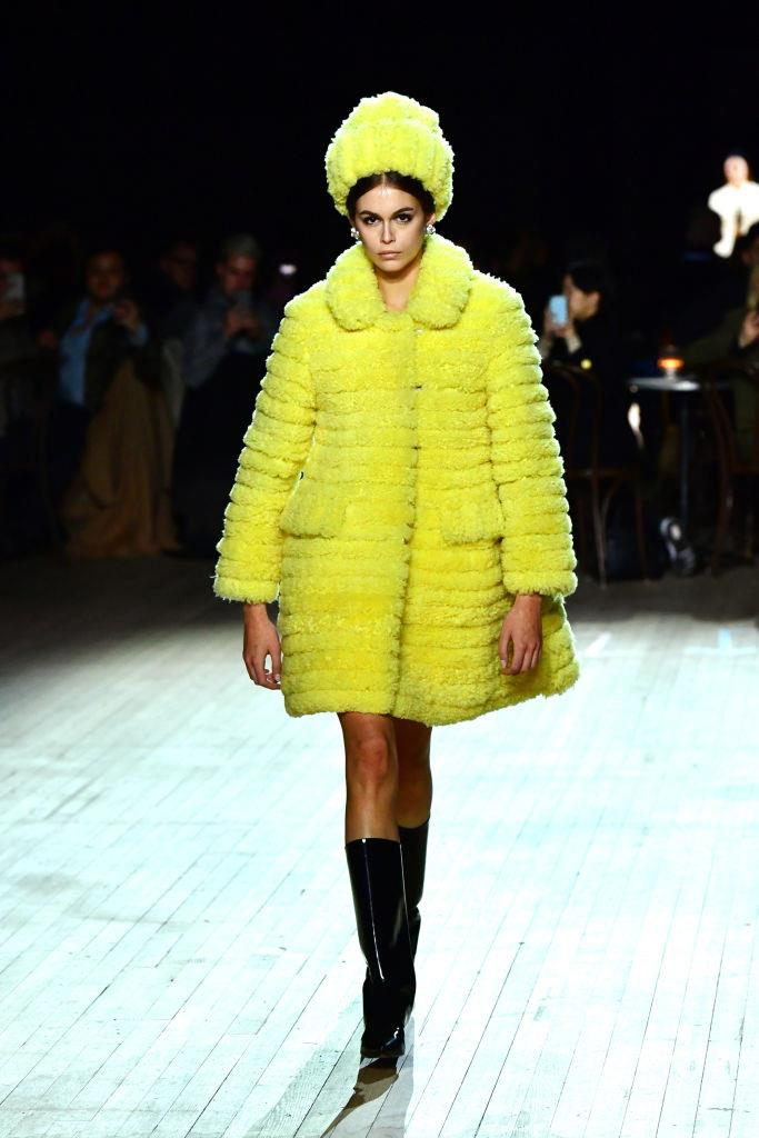 **Marc Jacobs** <br><br> In addition to Bella Hadid's Jackie Kennedy moment, Kaia Gerber's fluffy, yellow-tiered coat became all grown up with the addition of black patent leather boots. <br><br> *Image: Getty*