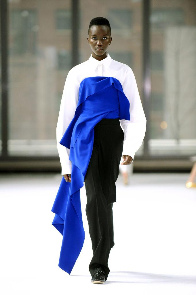 **Carolina Herrera** <br><br> What's more, the label danced even further with the idea of deconstruction and asymmetrical silhouettes—from their popular one-shoulder dresses, to this unique suit-meets-gown look. <br><br> *Image: Getty*