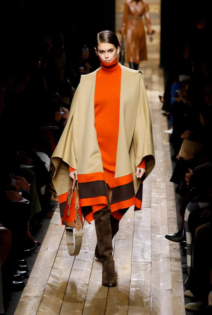 **Michael Kors** <br><br> Kors' runway presentation involved the most wearable of winter garments, including giant scarves, shearling coats, and this heavenly poncho-reminiscent look worn by Kaia Gerber. (Bonus points for the snuggly-looking long turtleneck, which we'd nab in a heartbeat.)