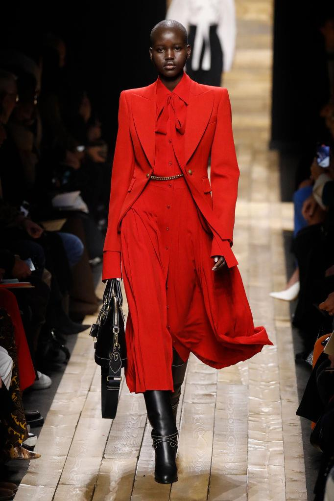 **Michael Kors** <br><br> It-girl Adut Akech was a vision in this dramatic lipstick-red blazer and coordinating pussy-bow dress, which, with the matching leather bag and knee-high boots, made for one of our favourite looks of the night.