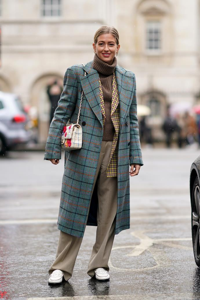 **Oversized Coats** <br><br/> The coat is very much a reliable cold weather staple but the street style set went for exaggerated, oversized options this season. Textures were thick, there was a nod to 80s accentuated shoulders but colours were very 70s—think rich browns, oranges and muted greens.
