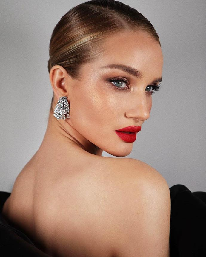 """***Any notes on hair and makeup?***<br><br>  """"Everything from head-to-toe should be preened to perfection,"""" said Nina.<br><br>  """"[Think] defined natural brows, a smudge of pencil blotted onto the lip, contoured cheekbones and hair pulled back into a sleek low bun, which you can do with a touch of post-shower texture.<br><br>  """"The slightly undone feel complements the sweeping romance of your ball gown and heavily embellished jewellery in a way that's both fresh yet wholly polished.""""<br><br>  *Image via @hungvanngo*"""