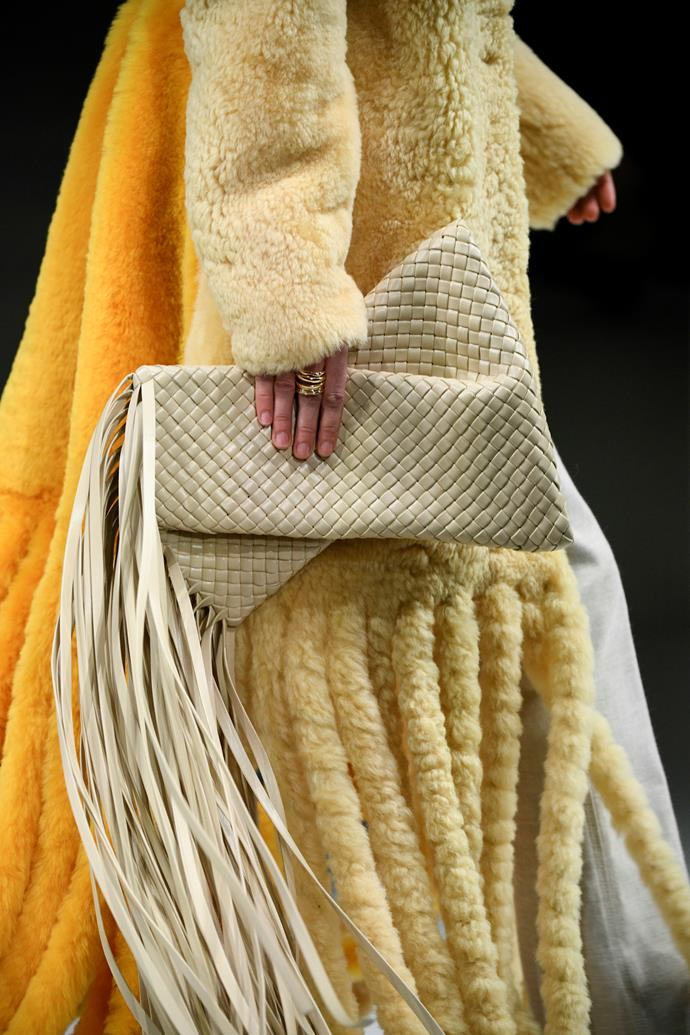 **Bottega Veneta's** 'Pouch' bag is back for autumn/winter '20, albeit with a few major updates—one being that long dramatic fringe (a recurring theme throughout the show, and let's face it, the entire week). Other noteworthy pieces included the oversized shearling coats and the colourful, unorthodox ankle-length wellies.