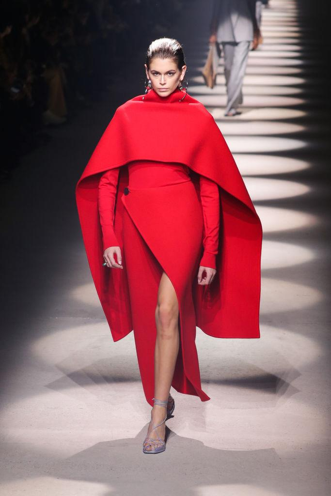 **Givenchy** <br><br> Following her exquisite couture collection in January, Clare Waight Keller's Givenchy pivoted back to its trademark simplicity this season. This meant floppy hats, gentle patterns and sharp suiting, as well as an exaggerated version of her famous cropped cape silhouette (seen here on Kaia Gerber).