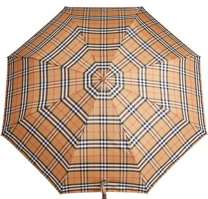 "Vintage check folding umbrella by Burberry, $400 at [Farfetch](https://www.farfetch.com/au/shopping/women/burberry-vintage-check-folding-umbrella-item-12963268.aspx?storeid=11115|target=""_blank""|rel=""nofollow"")."