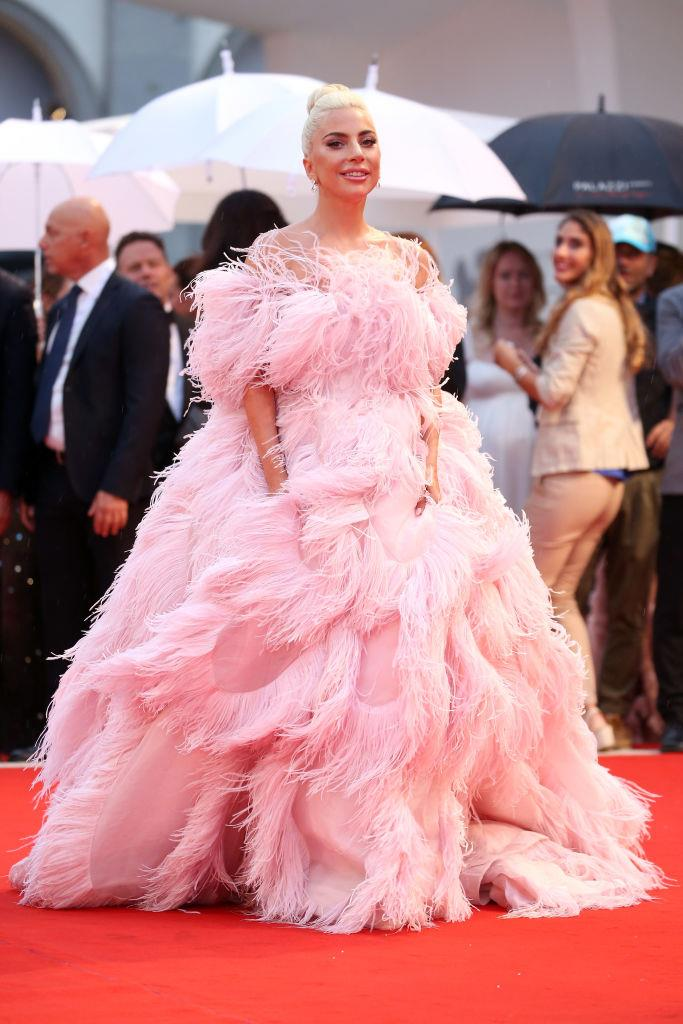 **Lady Gaga in Valentino Haute Couture at the Venice Film Festival (2018)** <br><br> We all know Lady Gaga for her music and whimsical fashion sense, but her performance in *A Star Is Born* showed her as a talented and versatile actress, too. <br><br> During the film's promotional duties and the subsequent award season, Gaga's wardrobe helped her become one of the most-watched people on the red carpet, but this heavenly Valentino by Pierpaolo Piccioli feathered gown was what kicked *everything* off (and spurred gowns by Alexander McQueen, Louis Vuitton and Brandon Maxwell to follow). One look, and a red carpet force was reborn.
