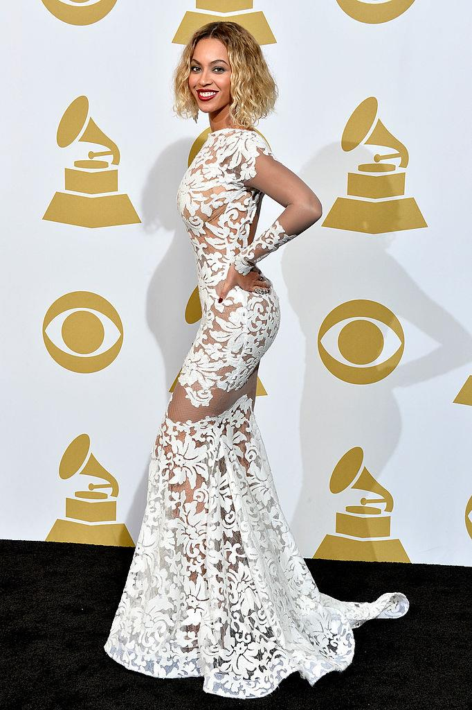 "**Beyoncé in Michael Costello at the Grammy Awards (2014)** <br><br> If you're a Beyoncé fan, you probably remember where you were the moment you saw the singer in her 2014 Grammys dress, sporting a dramatically shorter, wet-look hairstyle to match the wet waves in her ""Drunk In Love"" music video. <br><br> On the cusp of a more experimental musical era following the release of her self-titled 'visual album' in late 2013, this look marked the moment that Beyoncé ascended to an impenetrable level of music stardom—one that few have ever reached. It also marked the moment she'd become a total pop enigma: between then and now, she's only granted one or two interviews."