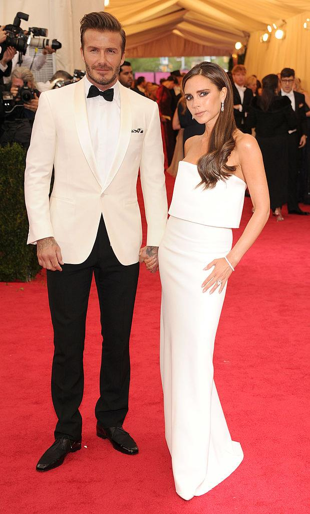 **Victoria Beckham in her own label at the Met Gala (2014)** <br><br> To us, Victoria Beckham has always been a queen, but there are a handful of moments that define her well-documented wardrobe trajectory—one of which was her appearance with husband David at the 2014 Met Gala. <br><br> Though vintage VB was known for her love of short Gucci dresses and exuberant, excessive style (some of which people found easy to make fun of), this gown, from her own eponymous label, showed her exhibit the kind of timelessly chic fashion aesthetic that's now become her signature. The dreamy top-half appears to levitate, the jewellery is minimal, and her beauty look is naturally pared-back and on-point.