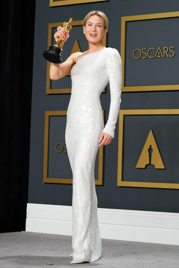 "**Renée Zellweger in Armani Privé at the Academy Awards (2020)** <br><br> When Renée Zellweger accepted her first Academy Award in 2004, she was mocked for her tulle Carolina Herrera dress, and over the years, she's been open about being [targeted](https://www.harpersbazaar.com.au/celebrity/renee-zellweger-surgery-response-19271|target=""_blank"") by the press and public. When she arrived at the 2020 Oscars to collect the Best Actress award, it was a ridiculously chic moment to remember. <br><br> Zellweger's column-like Armani Privé dress was divine, and her win signalled a new era for the *Judy* actress (as much as we'll always love/never forget *Bridget Jones*)."