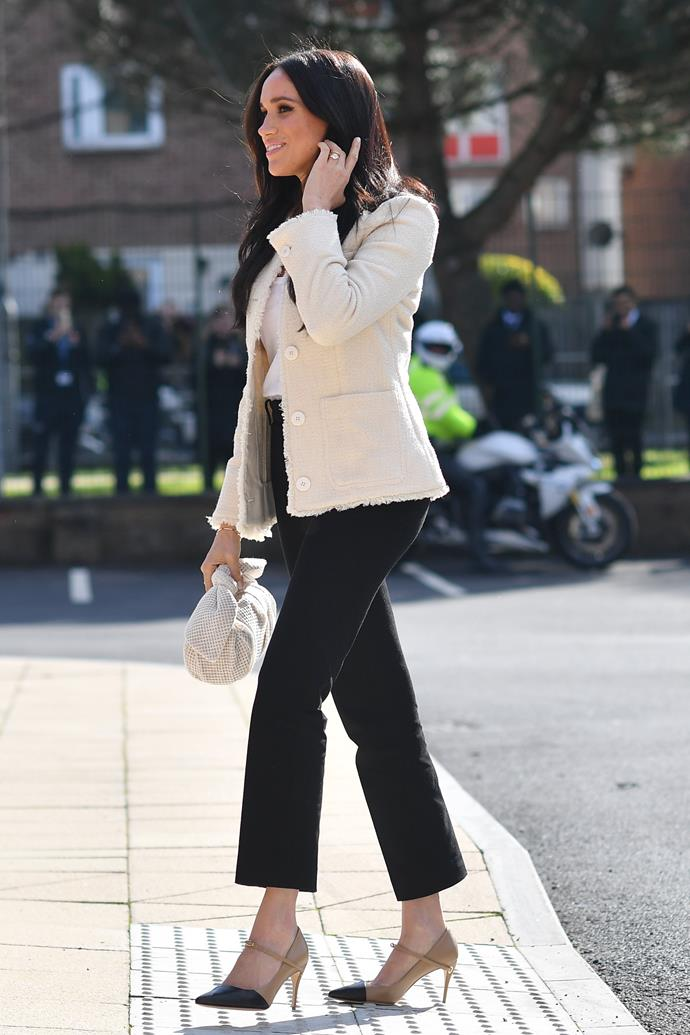 The Duchess of Sussex wore a cream boucle jacket by ME and EM for her IWD Dagenham school visit.