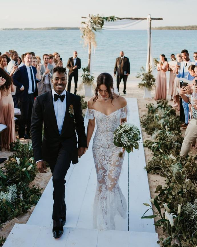 "**Shanina Shaik**<br><br>  Shanina Shaik wearing a lace, off-shoulder Ralph & Russo gown at her 2018 Bahamas wedding to DJ Ruckus.<br><br>  *Image via [@shaninamshaik](https://www.instagram.com/p/BiQFxatHDra/|target=""_blank""