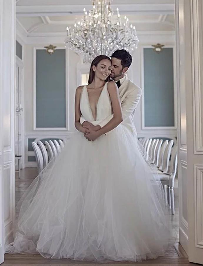 "**Ricki-Lee Coulter**<br><br>  Singer Ricki-Lee Coulter in her plunging tulle Johanna Johnson gown at her [2015 Paris wedding](https://www.nowtolove.com.au/lifestyle/weddings/ricki-lees-wedding-album-33278|target=""_blank""