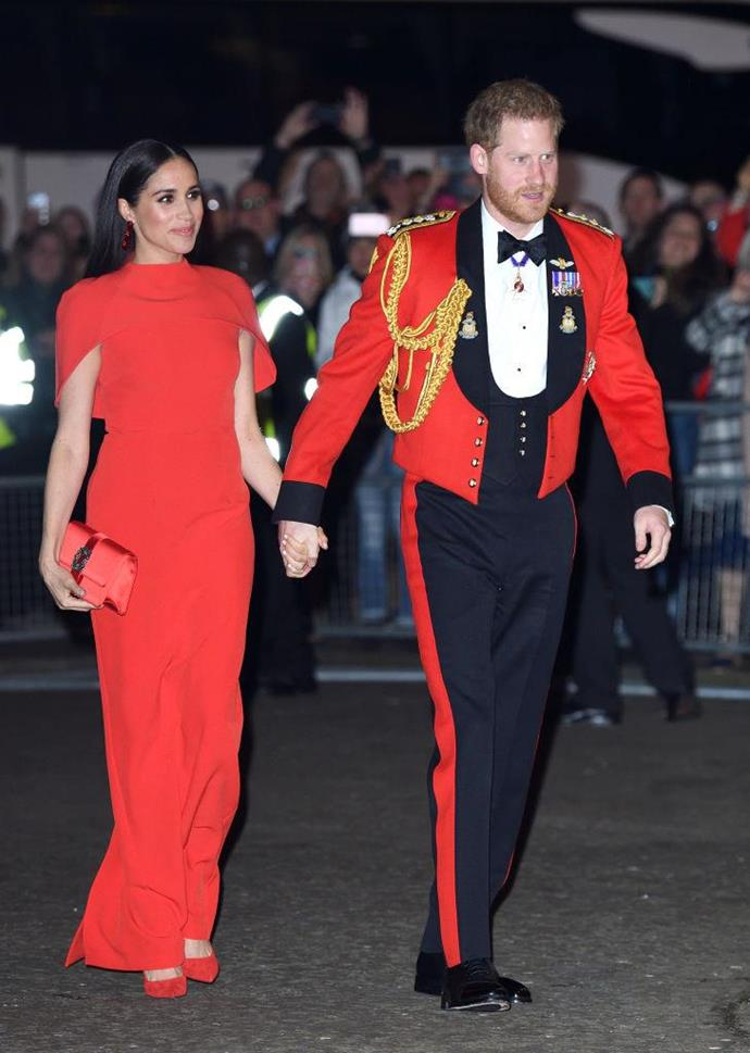 "**Meghan Markle and Prince Harry matching in red at the 2020 Mountbatten Festival of Music**<br><br>  Worn just weeks before they their pending date to step down as senior royals, [Meghan and Prince Harry's matching red ensembles](https://www.harpersbazaar.com.au/fashion/meghan-markle-prince-harry-red-outfits-meaning-20023|target=""_blank"") at the 2020 Mountbatten Festival of Music caught the eyes of royal watchers around the world.<br><br>  While one might be inclined to think their matching red looks simply represent solidarity with one another (or just well coordinated [couple dressing](https://www.harpersbazaar.com.au/fashion/celebrity-couples-dressing-19622