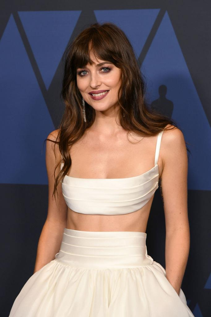 "**Dakota Johnson** <br><br> After becoming known for her role as Anastasia Steele in the *Fifty Shades* trilogy, Johnson stuck by an intense [workout schedule](https://www.cosmopolitan.com/health-fitness/a16763095/dakota-johnson-fifty-shades-freed-workout/|target=""_blank""