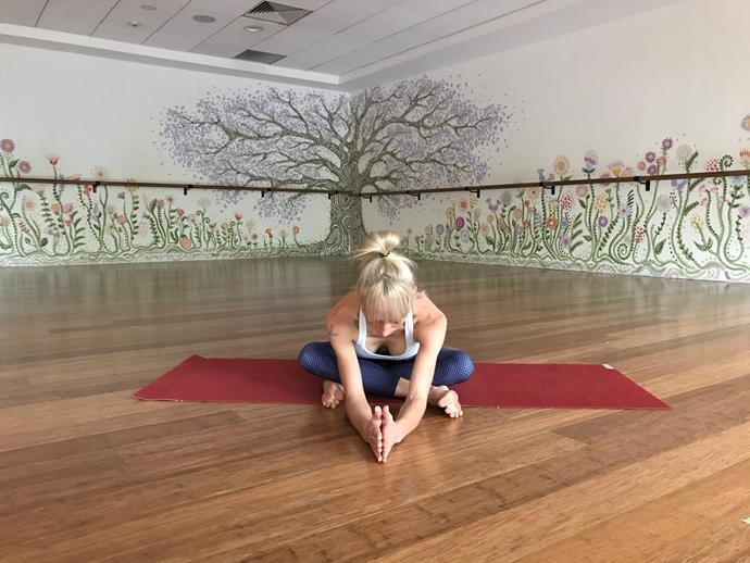 """**Easy Pose (Sukhasana)**<br><br>  Easy pose (or sukhasana) with a forward fold is especially great for those who tend to breathe shallow. Why? The forward fold enables you to feel when the breath enters your belly in a more pronounced way (as opposed to when you are upright).<br><br>  This encourages deeper breaths, which increase oxygen to the brain and help shift the body from the nervous system ('fight or flight') to the parasympathetic nervous system ('rest and digest'). And the benefits don't stop there.<br><br>  """"When folded forward, it's great for relieving tension in hips and spine,"""" Kendall adds.<br><br>  *How to:*<br><br>  1. Come into a cross-legged posture with right shin in front of left and your heels away from hips so that if you look down there is an upside down triangle.<br>  2. Keep your feet active as you lift arms above head and interlace the fingers.<br>  3. Exhale extend forward and place hands on ground shoulder width apart.<br>  4. Keeping the spine long, relax the shoulders and take 10 to 20 grounding breaths."""