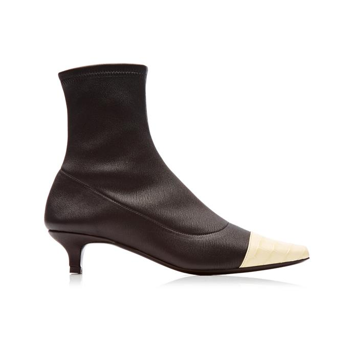 "**The two-tone piece** <br><br> Who doesn't love a black-and-white (or in this case, ivory) boot? By Far's two-toned ankle boots make outfit experimentation all too easy, with the aid of a leg-clinging leather cut and wearable-but-still-noticeable pump. <br><br> *'Karl' two-tone stretch-leather boots by By Far, $810 at [Moda Operandi](https://fave.co/2JoLOxx|target=""_blank""