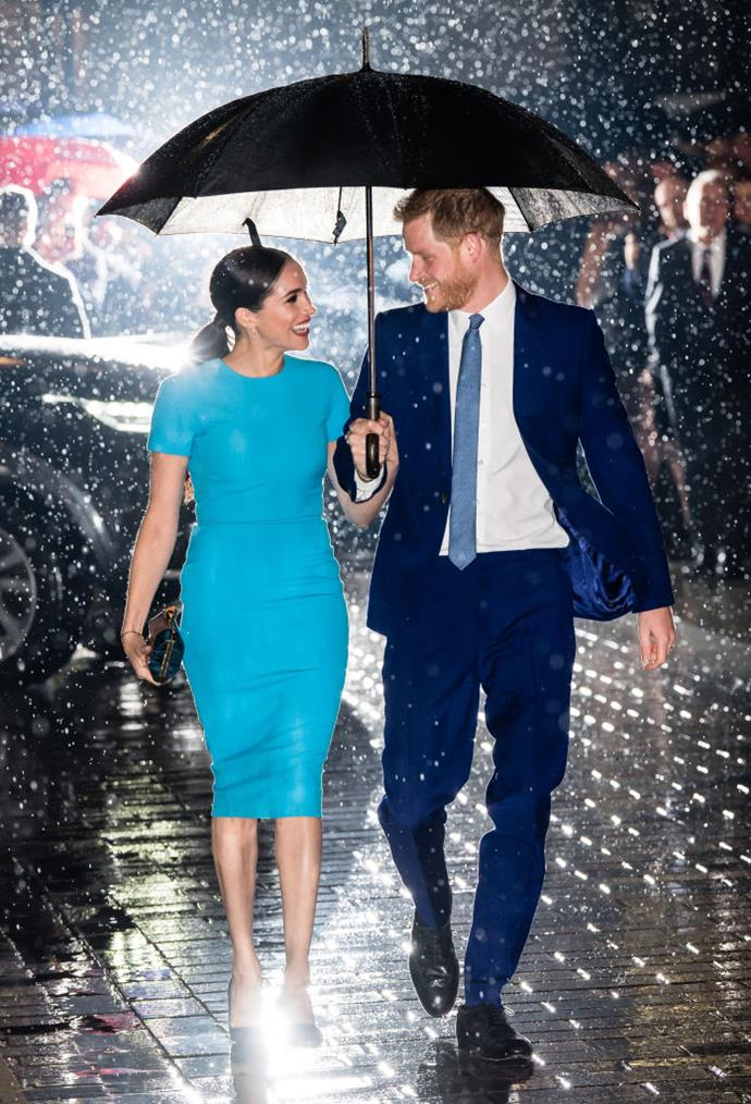 "**March 2020: Meghan Markle and Prince Harry attend the first of their final engagements as senior royals**<br><br>  If anything can be declared 'iconic' in 2020, it was the radiance-redefining image of Meghan Markle and Prince Harry beaming under one umbrella, with rain sparkling around them, as they attended the first of their final engagements as senior royals.<br><br>  The photo, which seemingly captured their joy at the impending emancipation and prompted the coining of the term ['renaissance dressing'](https://www.harpersbazaar.com.au/fashion/renaissance-dresses-20032|target=""_blank""), also saw [Meghan's blue Victoria Beckham dress](https://www.harpersbazaar.com.au/fashion/meghan-markle-blue-dress-20015