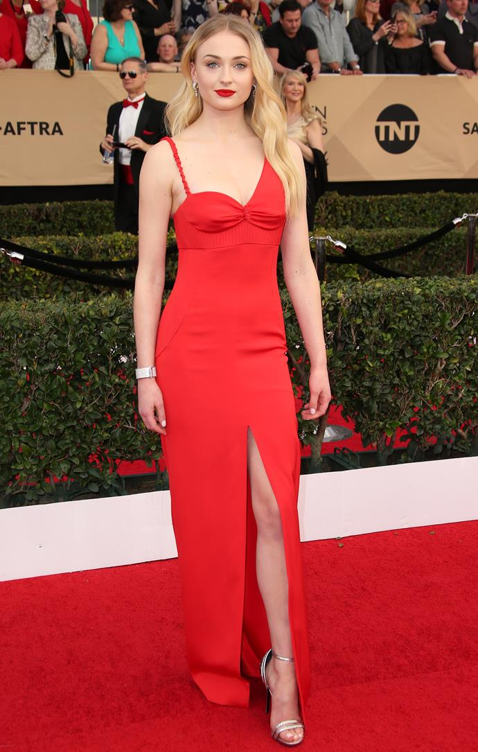 A lesson in bold minimalism. The tomato-red gown, complementary lip and soft waves landed Turner's 2017 SAG Awards old Hollywood look firmly in our hearts forever.