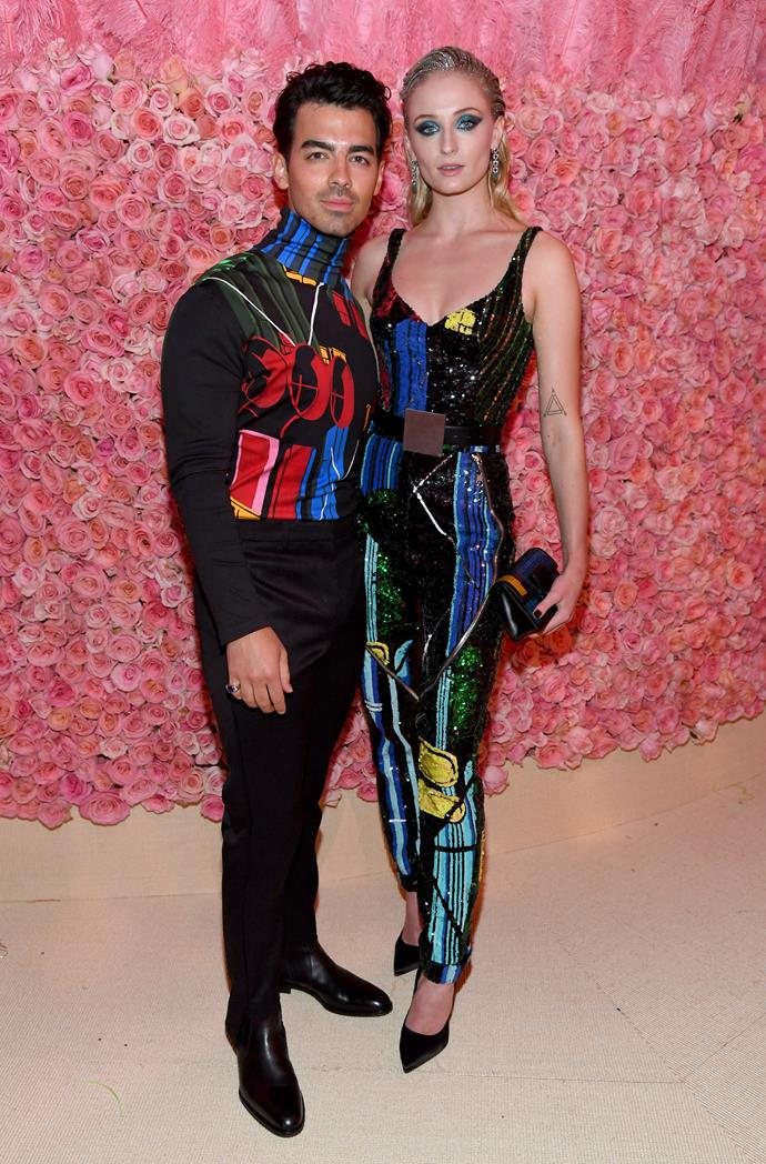Sequins, colour-blocking and stunning silhouettes—three of our favourite things. Turner turned up the heat at the 2019 Met Gala in a bold jumpsuit and glam makeup to match. (Petition to make coordinated S.O. outfits a thing.)
