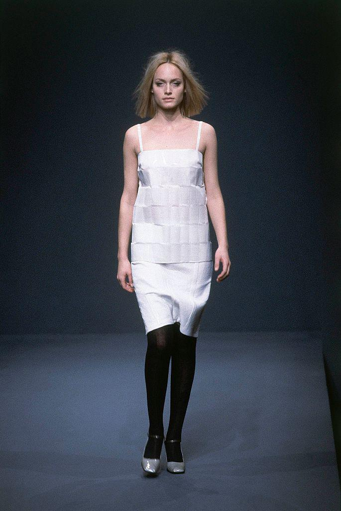 """**Amber Valletta** <br><br> Many people know Valletta from her roles in *Hitch* and *What Lies Beneath*, but she's actually one of the most influential supermodels of the 1990s and 2000s. She's pictured here walking for [Prada](https://www.harpersbazaar.com.au/fashion/prada-autumn-winter-2020-19952 target=""""_blank""""), a brand she worked closely with in the '90s, at their autumn/winter '98 show."""