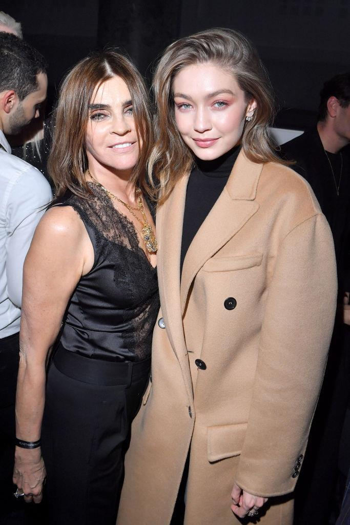 *BAZAAR* stylist Carine Roitfeld, another celebrity donor, pictured with Gigi Hadid in 2019.